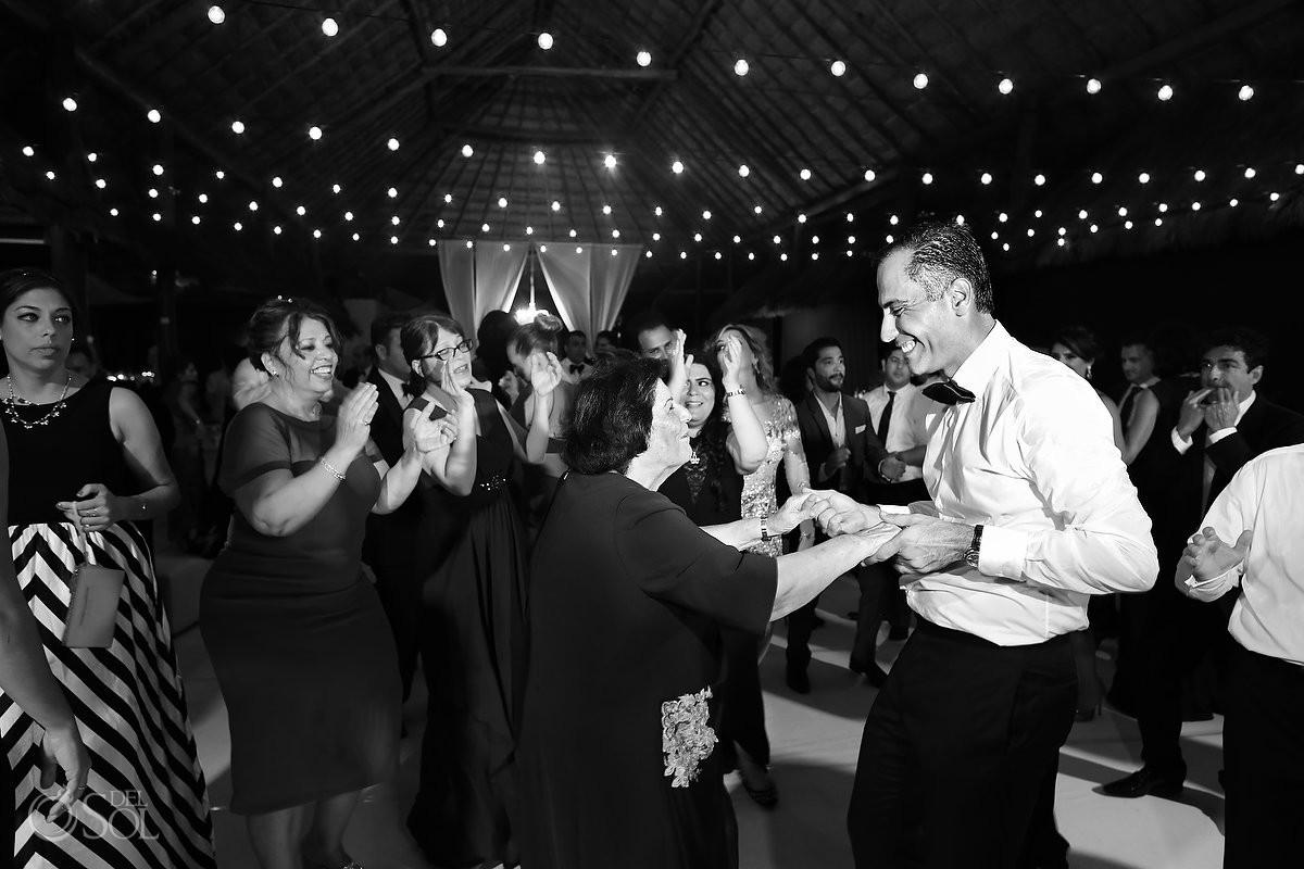Groom dancing Palapa wedding reception, mehmoonee, Rosewood Mayakoba, Playa del Carmen, Mexico