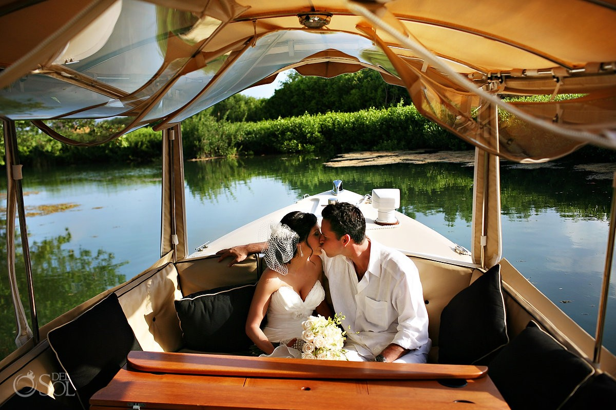 Bride groom wedding portrait boat canal kiss rosewood mayakoba