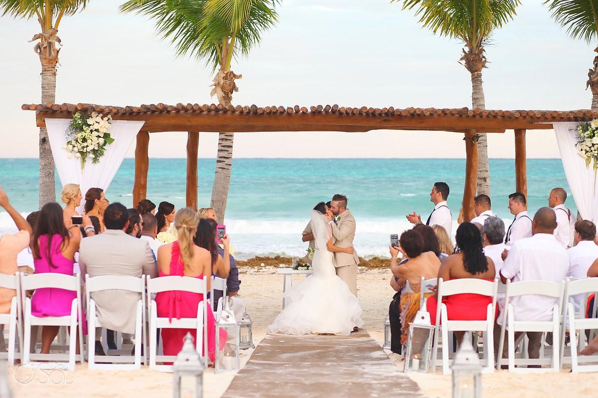 First kiss beach wedding ceremony Secrets Maroma, Riviera Maya, Mexico