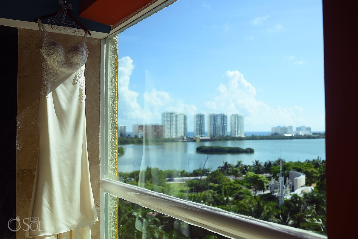 Wedding dress hanging window Cancun view, Wedding at Dreams Sands Cancun Resort,, Mexico