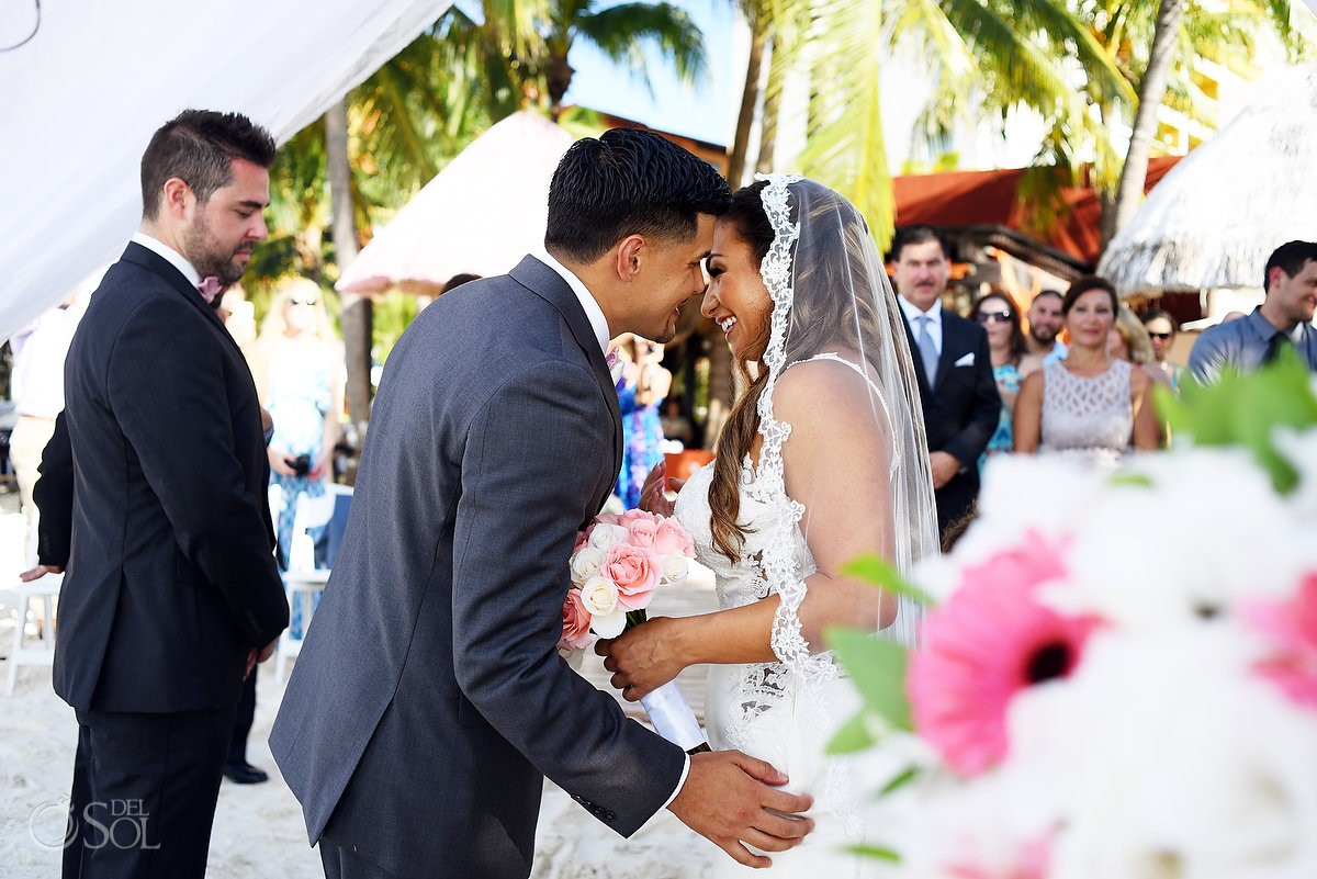 intimate moment Beach Wedding ceremony Dreams Sands Cancun Resort, Mexico