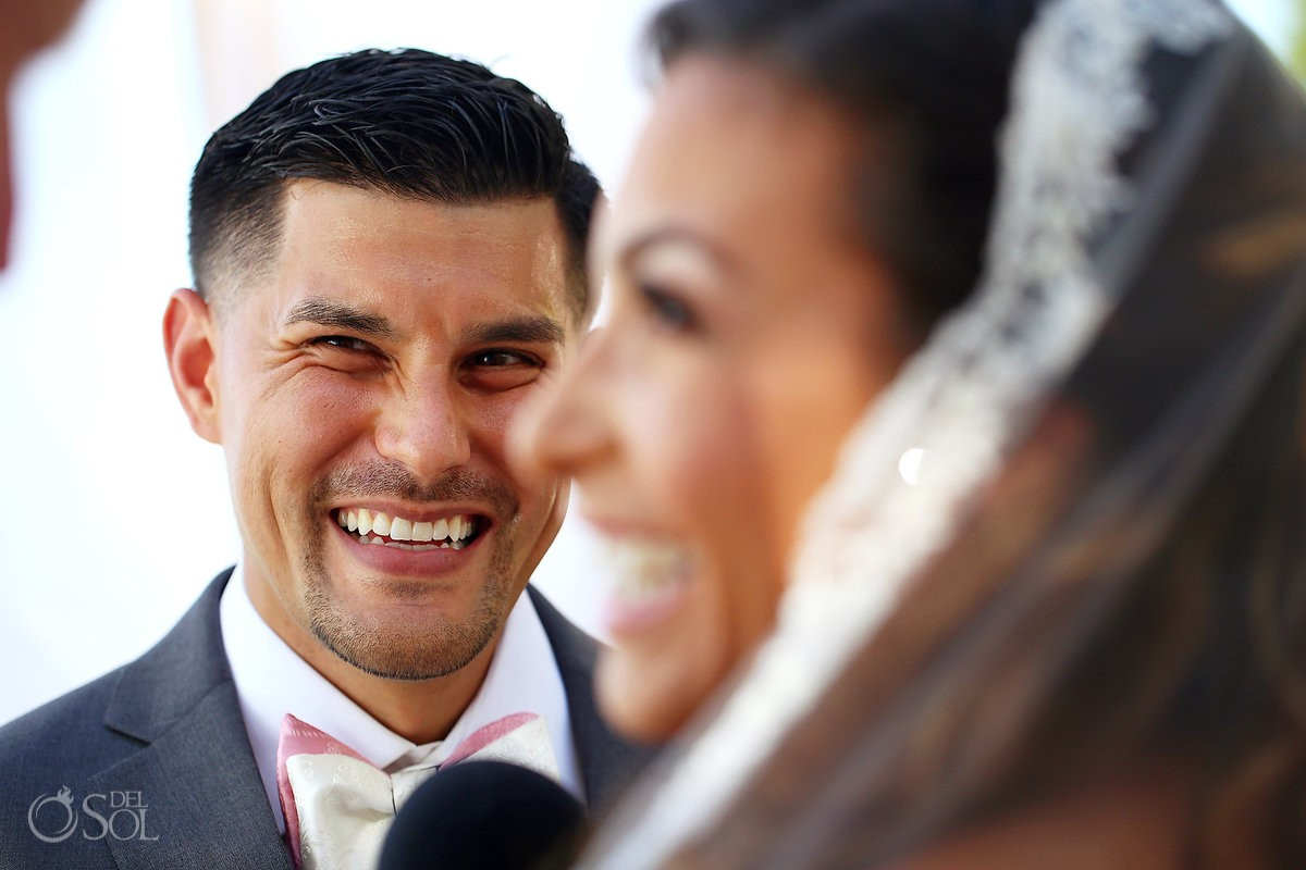 Groom smile Beach Wedding ceremony Dreams Sands Cancun Resort, Mexico