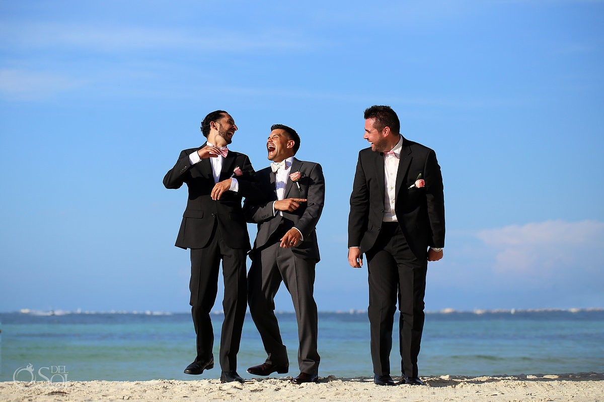 Groomsmen candid laughing blue ocean, Bridal Party portraits Dreams Sands Cancun Resort, Mexico