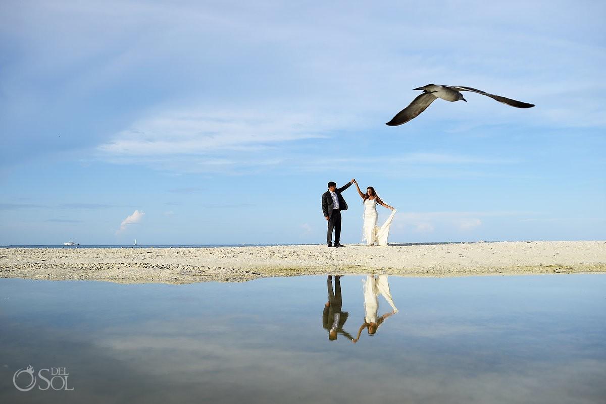 Artistic ocean reflection wedding portrai bird flying, Beach Wedding Dreams Sands Cancun Resort, Mexico