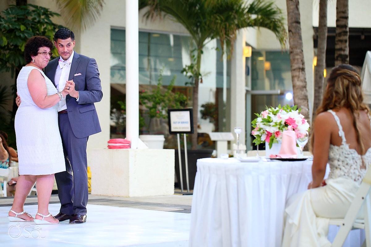 Bride watches mother son dance Wedding Reception, El patio terrace, Dreams Sands Cancun, mexico