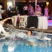 bride groom jumping swimming pool splash, Wedding Reception, El patio terrace, Dreams Sands Cancun, mexico