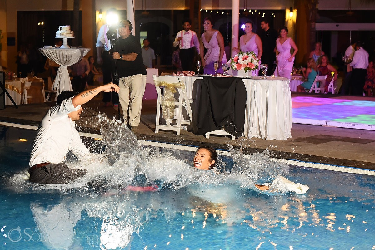 bride groom jumping swimming pool splash, Wedding Reception, El patio terrace, Dreams Sands Cancun, mexico