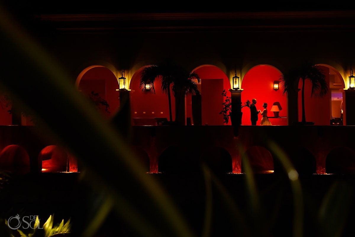 Creative night time red silhouette Wedding portraits Valentin Imperial Maya, Playa del Carmen, Mexico