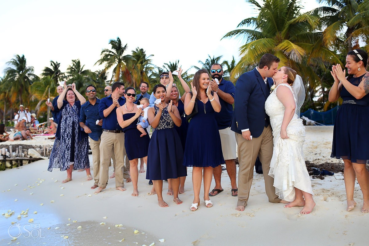 guests throwing flowers for cosmic wedding ceremony on isla mujeres