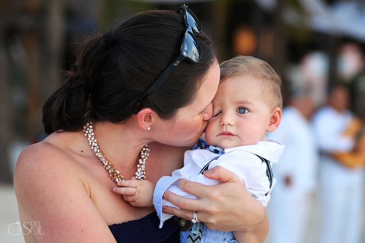 cute baby at beach destination wedding on isla mujeres