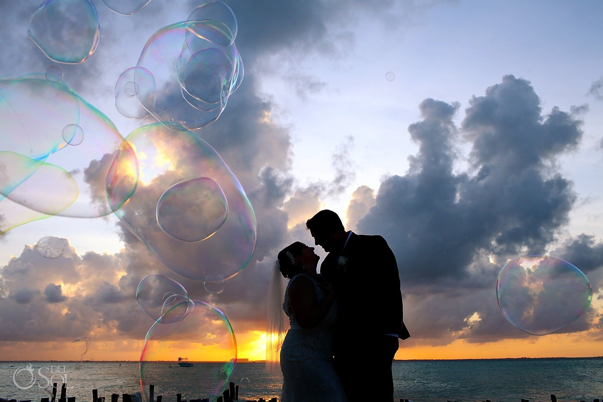 bride and groom with bubbles at beach destination wedding on isla mujeres