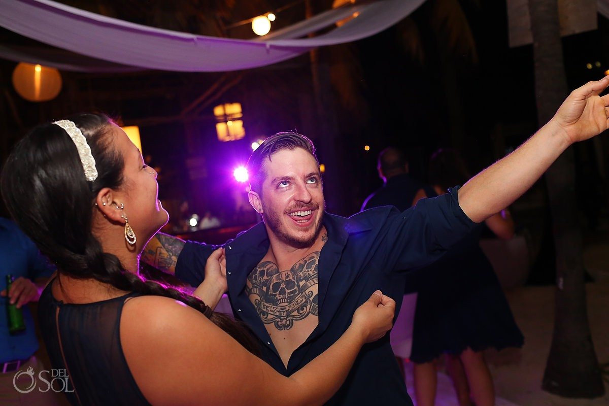 tattooed guest dancing at isla mujeres destination wedding