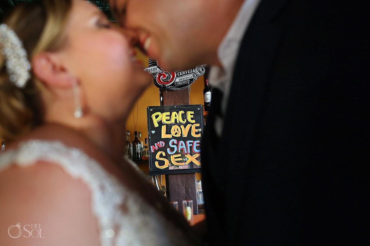 Peace, love, safe sex: funny chalk board sign caribbean bar, Isla Mujeres. Creative Wedding Portrait, Caribbean beach bar