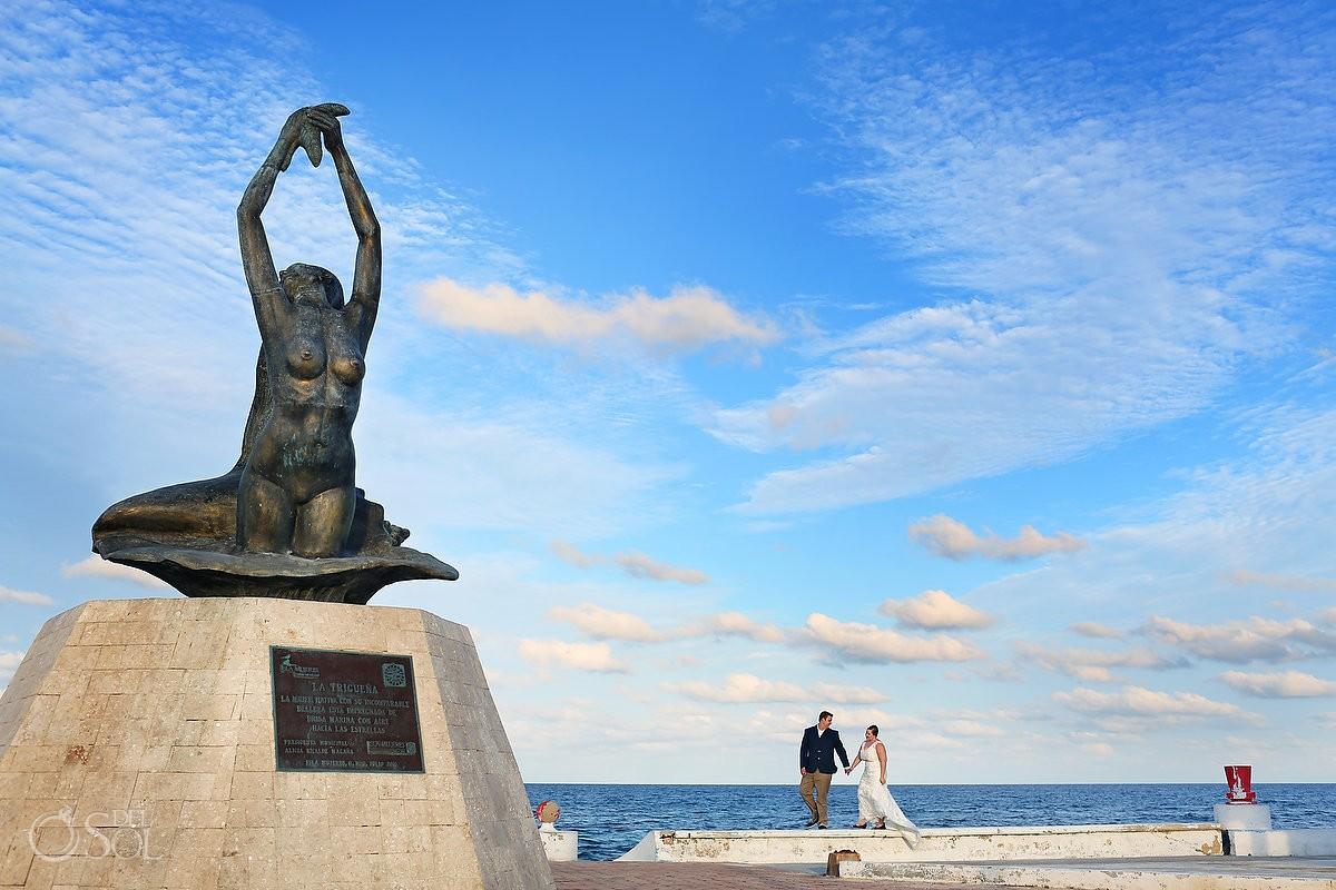Wedding Portraits bride groom walking ocean front, sculpture, Isla Mujeres, Mexico
