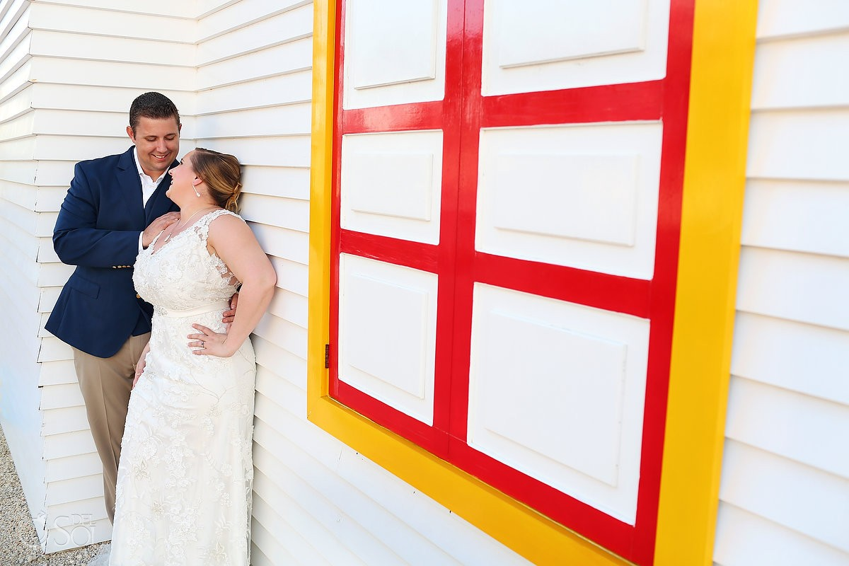 Wedding Portraits, colorful building Caribbean Island, Isla Mujeres, Mexico