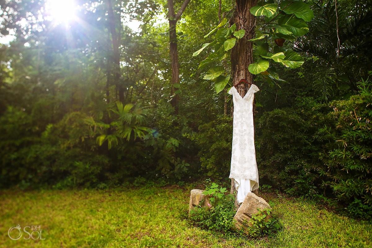 Wedding dress hanging tree gardens Hacienda Uayamon, Campeche, Mexico