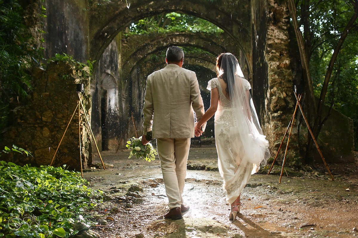 Wedding portrait walking rain chapel ruins, Wedding Hacienda Uayamon, Campeche, Mexico