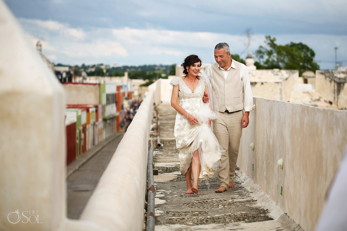 wedding portrait bride groom walking Campeche city walls, Mexico