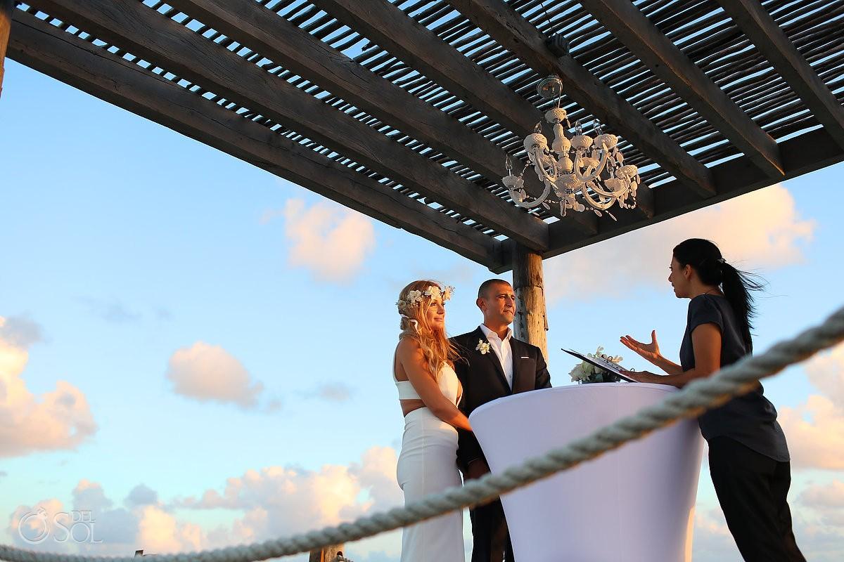 Elopement ceremony pier golden hour, NIZUC Resort, Cancun, Mexico.
