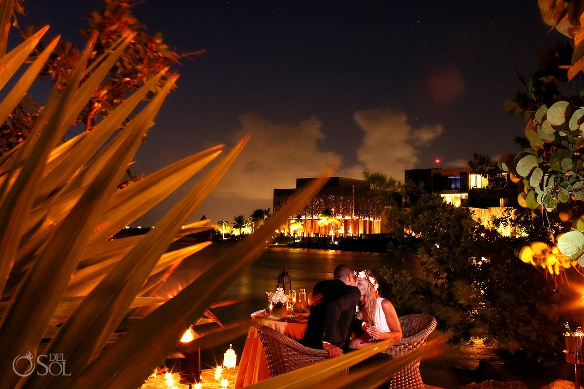 romantic wedding dinner bride groom kiss Elopement NIZUC Resort, Cancun, Mexico.