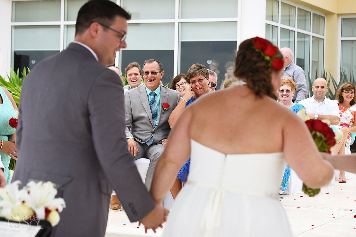 parents crying and celebrating during recessional at now jade destination wedding