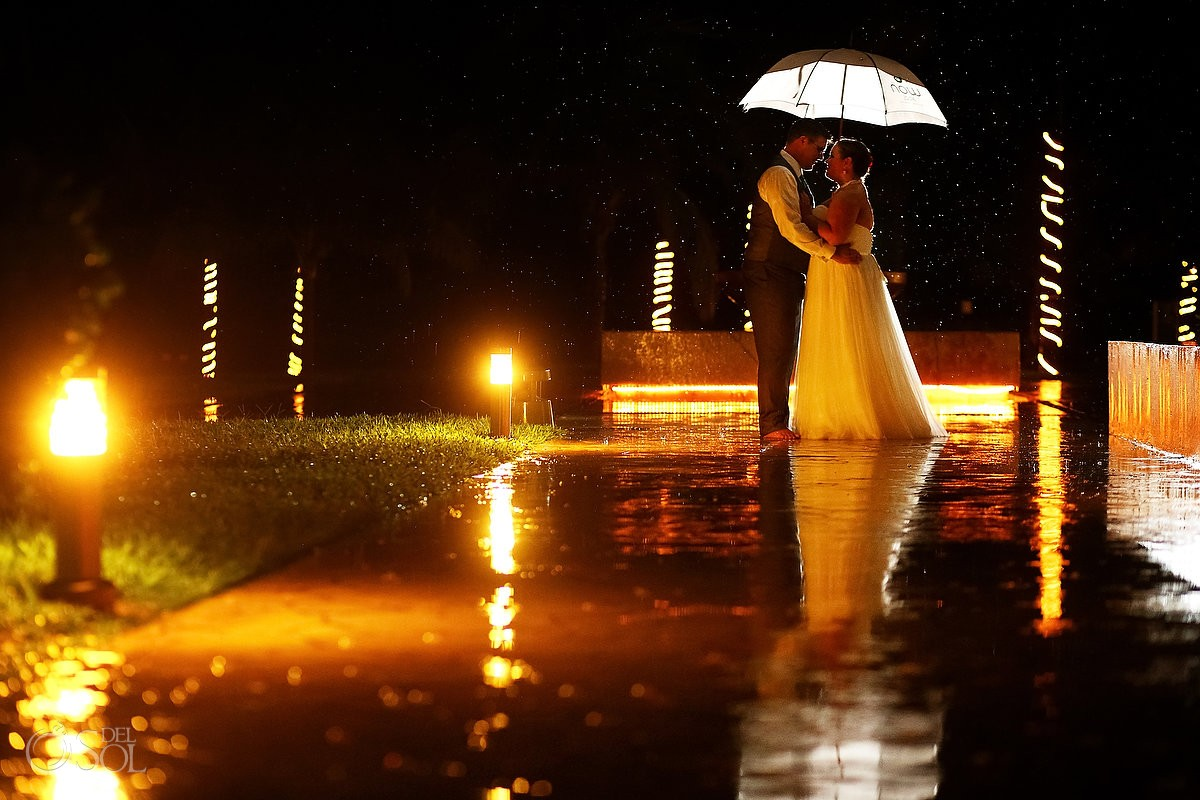 bride and groom in the rain at now jade hotel mexico