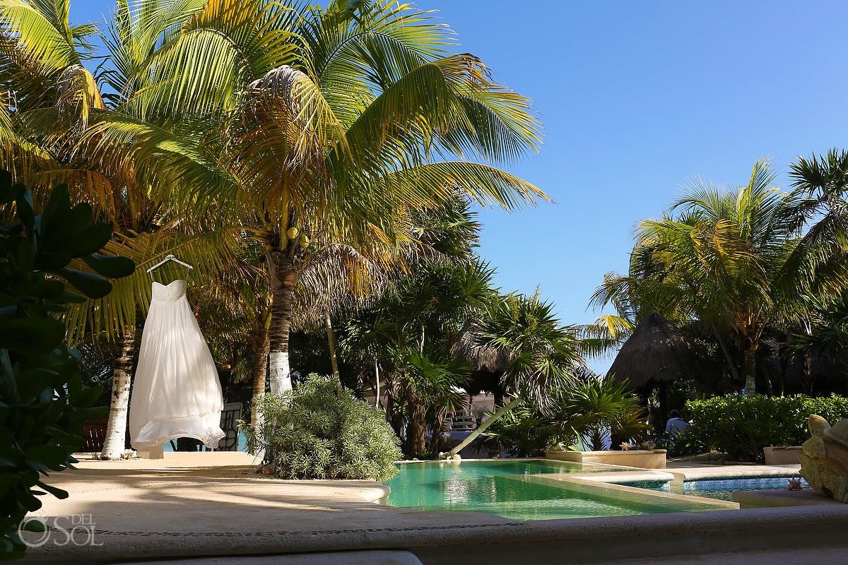 Wedding dress hanging swimming pool Sombras del Viento, Soliman Bay, Riviera Maya, Mexico