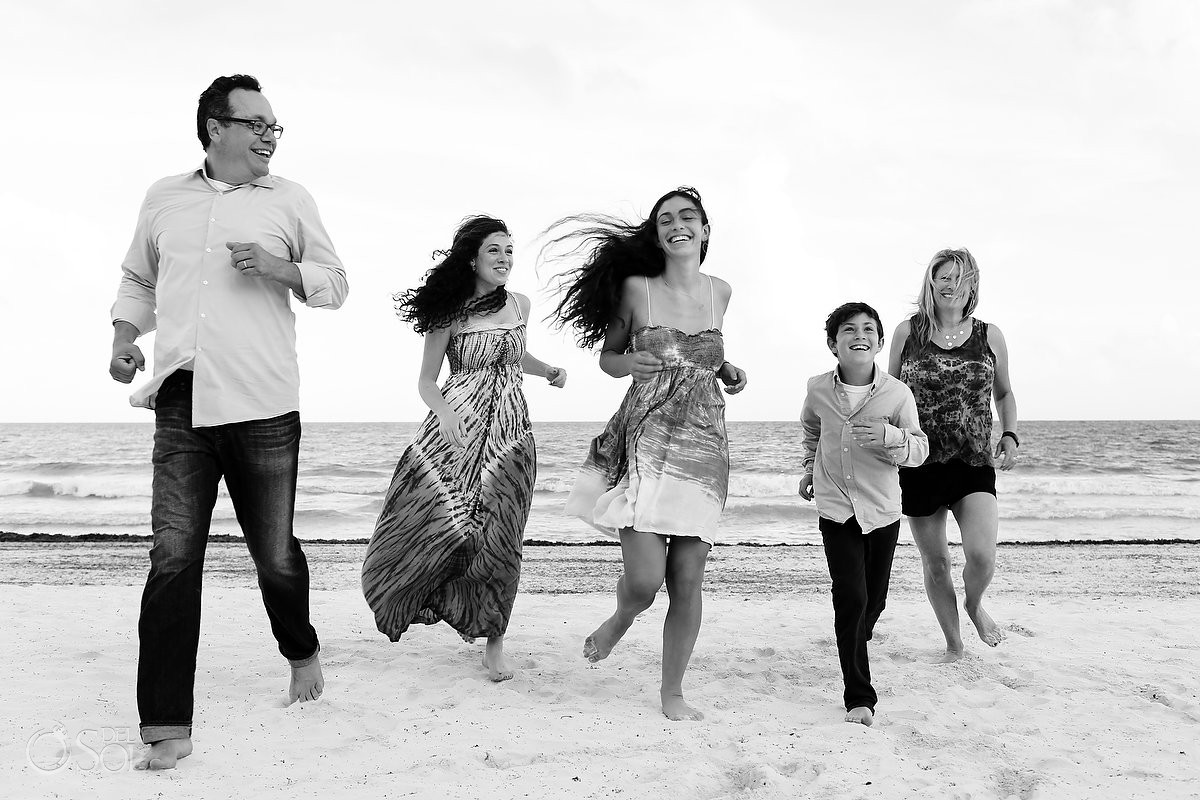 Black white family portrait running beach, Belmond Maroma, Playa del Carmen, Mexico