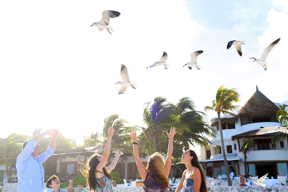 birds seagulls flying above family arms up, Portraits Belmond Maroma, Playa del Carmen, Mexico