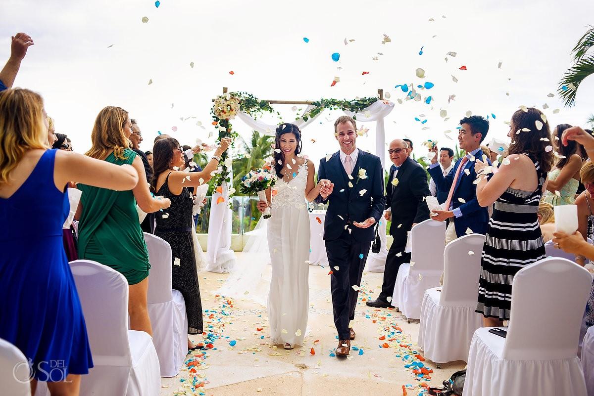 Wedding ceremony exit throwing color rose petal, terrace Live Aqua Cancun, Mexico