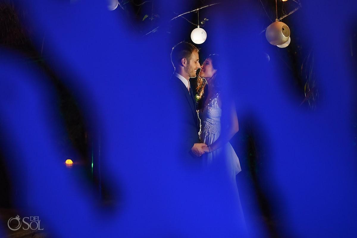 Creative framing blue light night wedding portrait, reception Live Aqua Cancun, Mexico