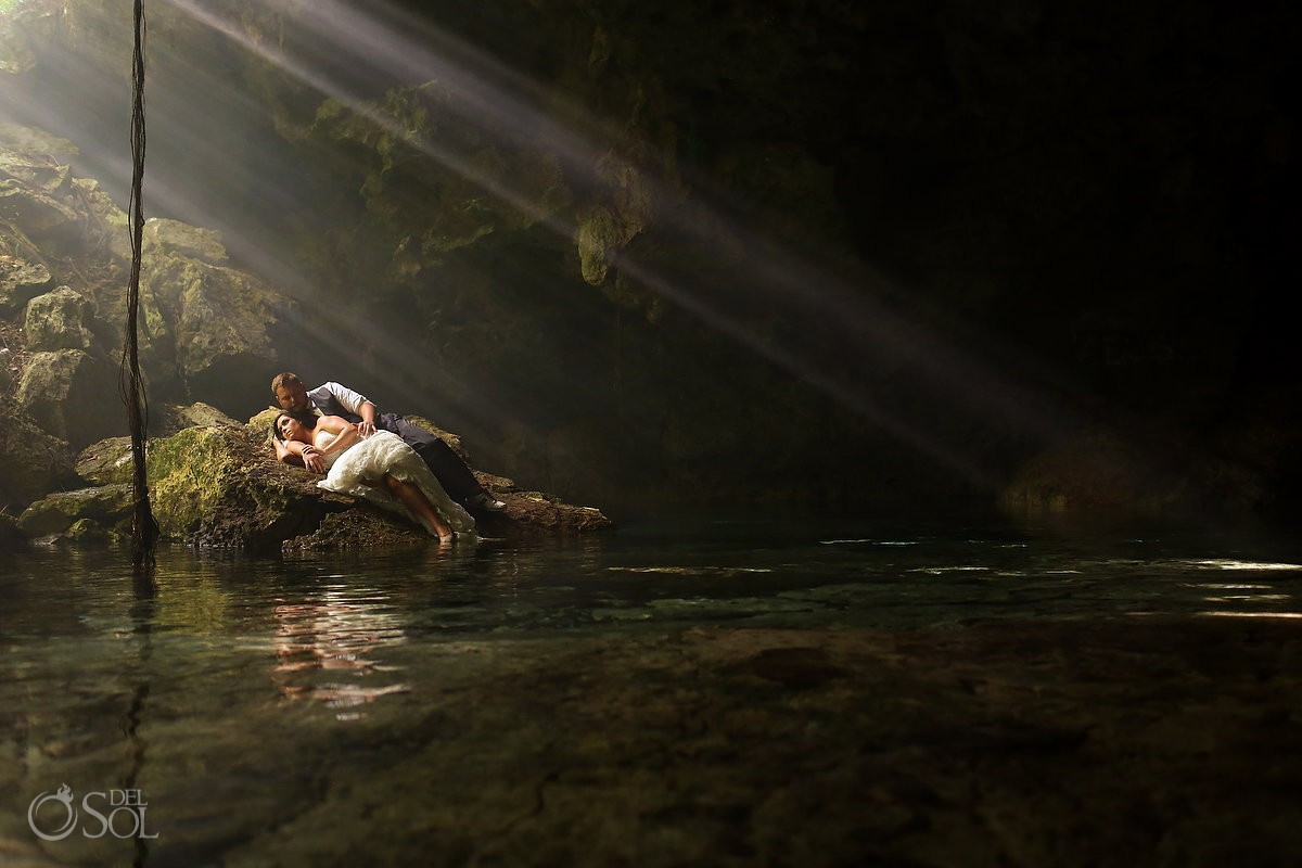 bride groom lying water edge, Cenote trash dress, cave, Riviera Maya, Mexico