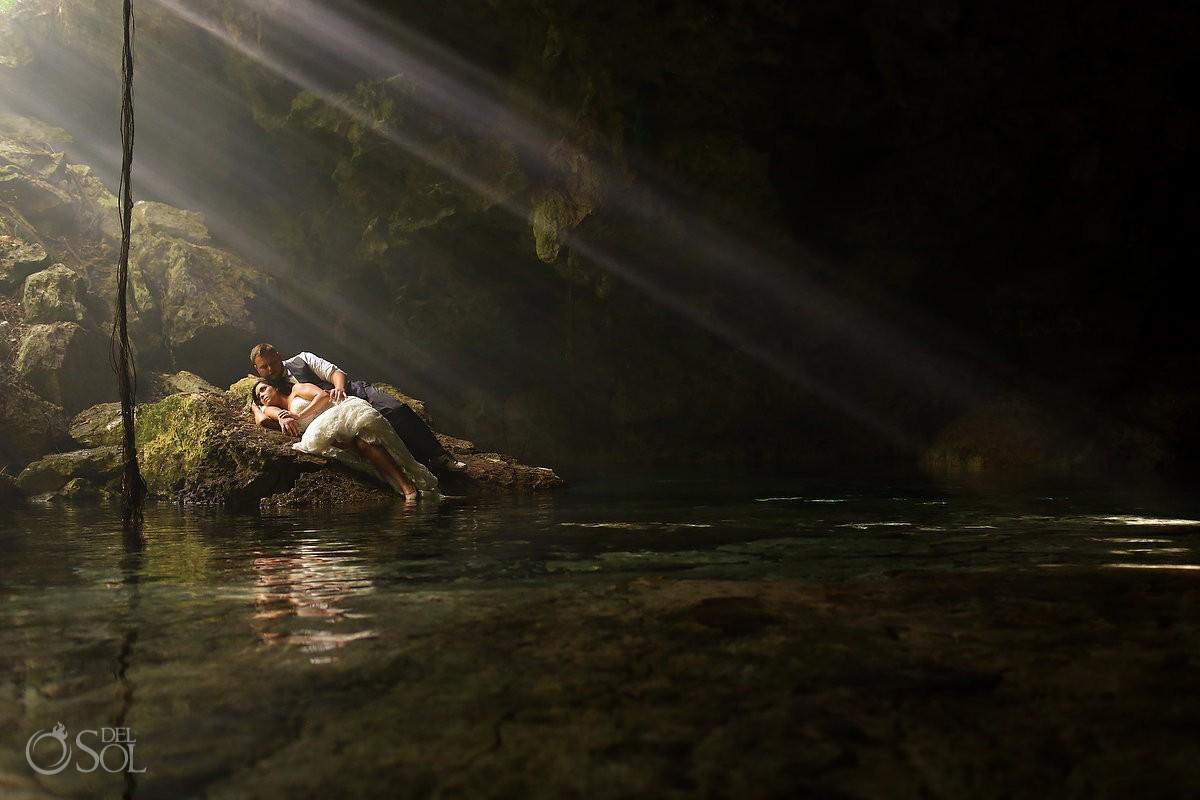 bride groom lying water edge, Cenote trash dress, cave, Riviera Maya, Mexico