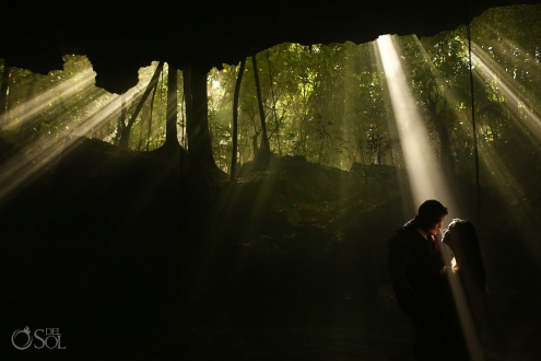 creative wedding portrait bride groom silhouette rays of light, dramatic, Cenote trash dress, cave, Riviera Maya, Mexico