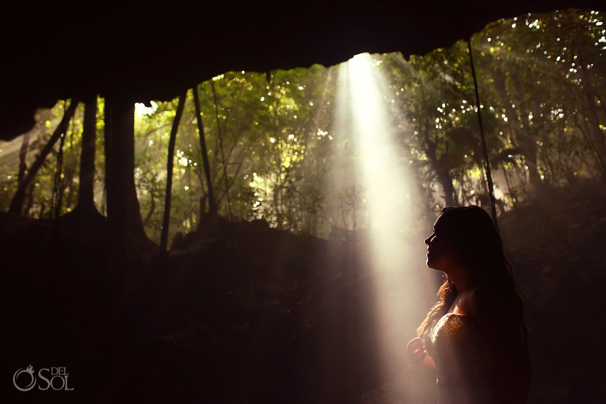 dramatic bride silhouette ray light, cenote Trash the Dress, Riviera Maya, Mexico.