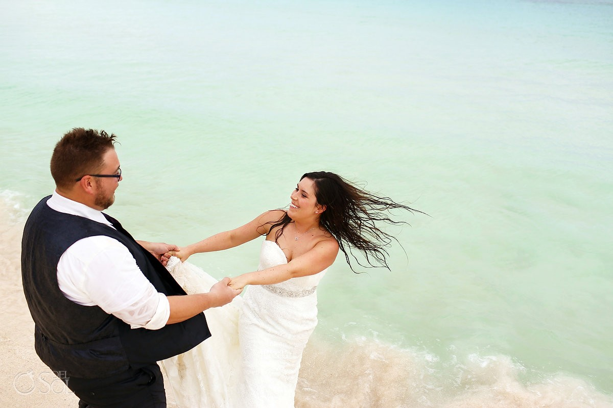 fun wedding photo bride groom spinning beach Trash Dress, Riviera Maya, Mexico.