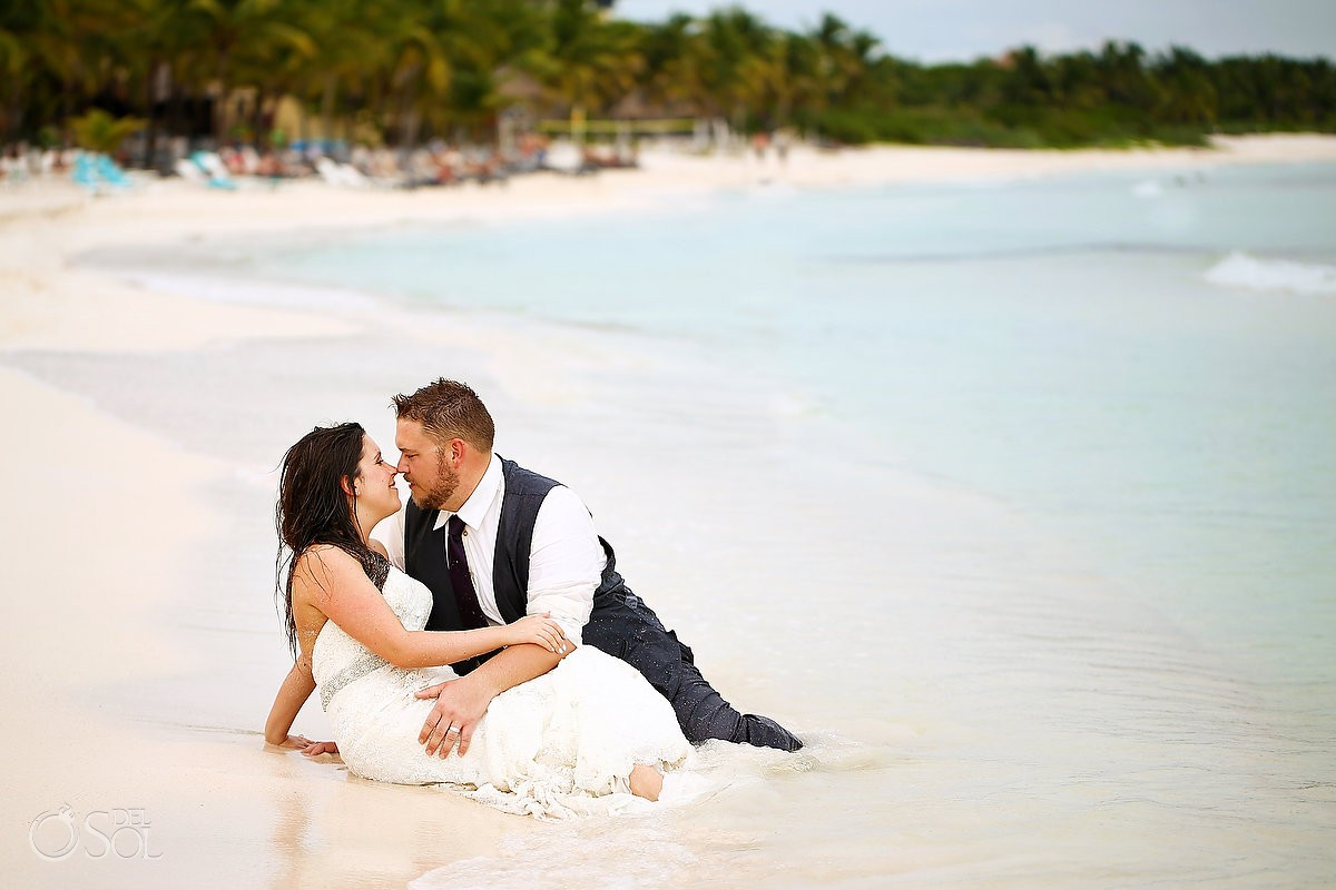 bride groom lying sand, beach Trash Dress, Riviera Maya, Mexico.
