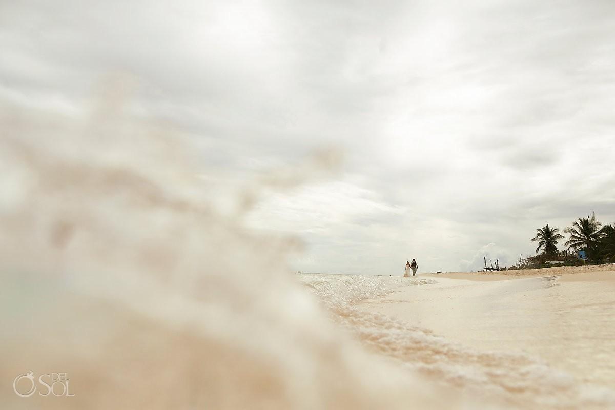 tiny bride groom silhouette wave, cenote Trash Dress, Riviera Maya, Mexico.