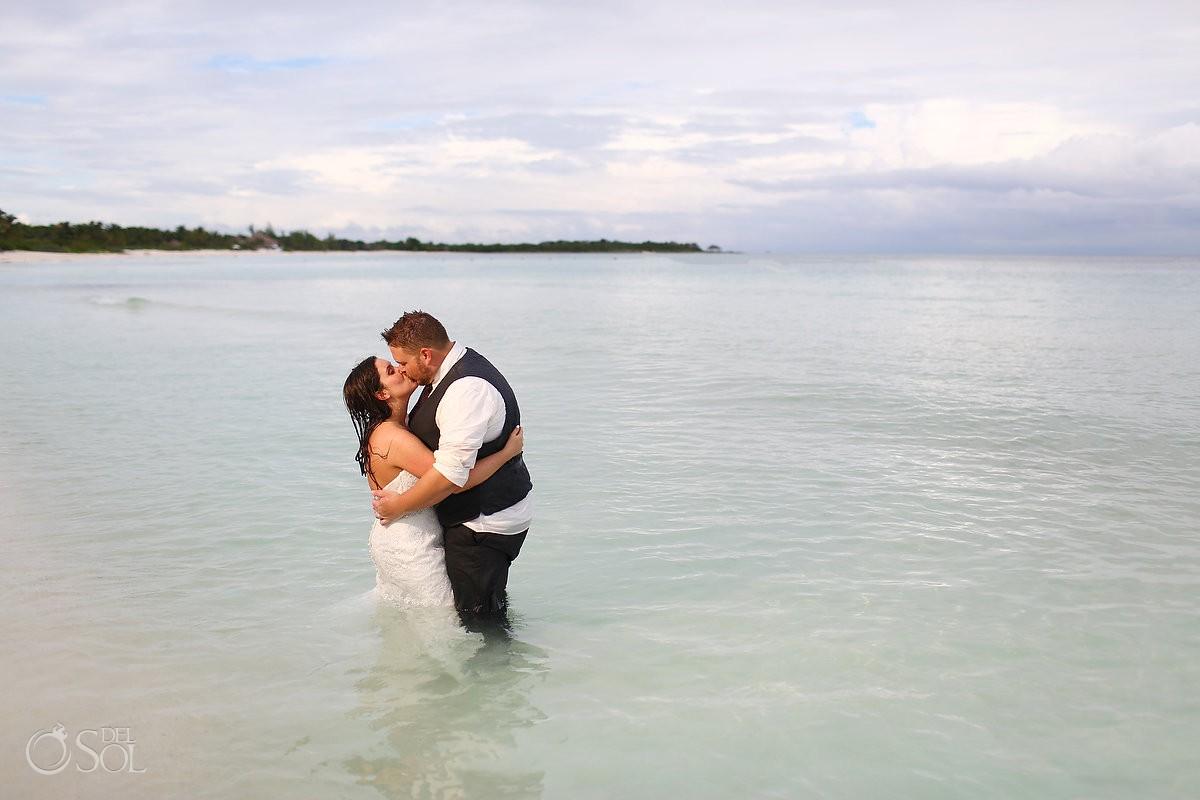 bride groom kiss ocean , beach Trash Dress, Riviera Maya, Mexico.