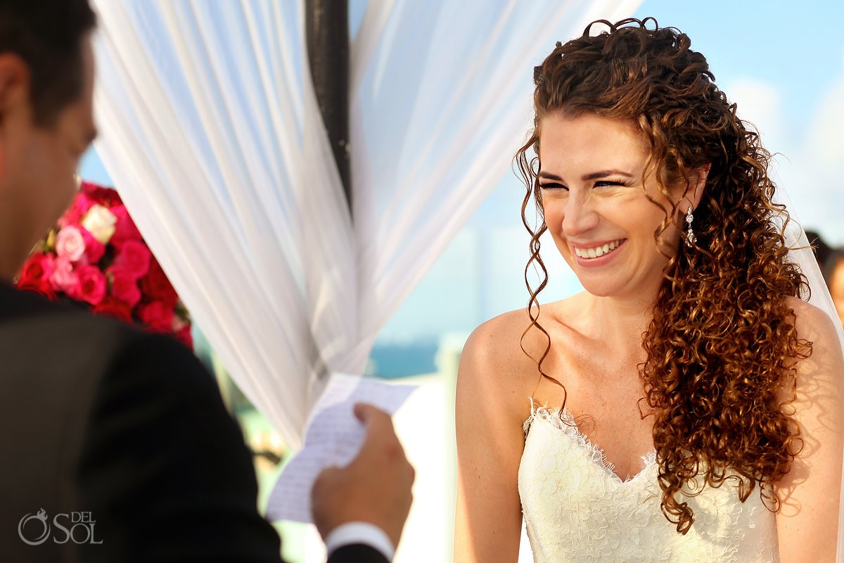 bride laughing grooms vows, Rooftop Wedding, sky deck, Beach Palace, Cancun, Mexico
