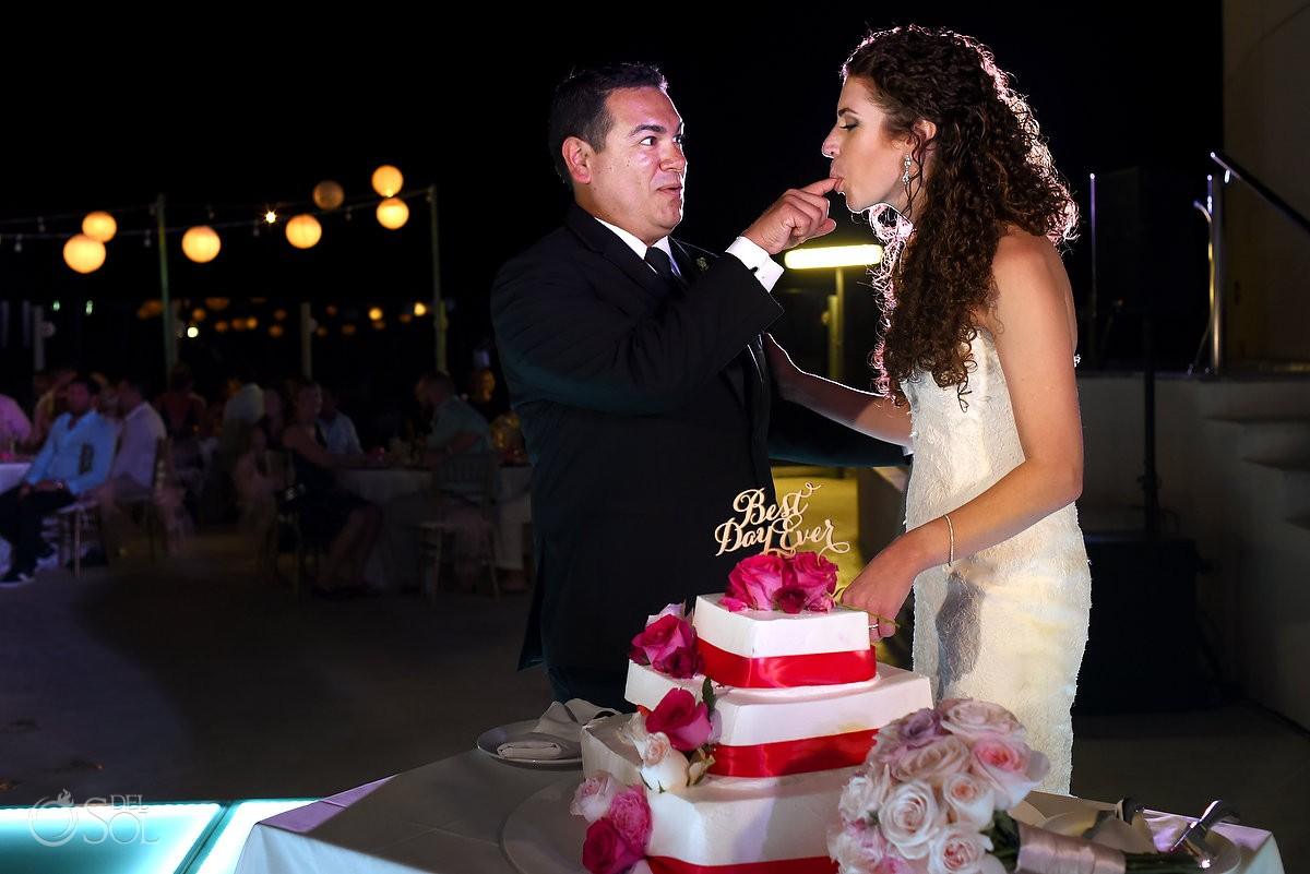 funny wedding cake picture, bride sucking groom finger, wedding reception, sky terrace, Beach Palace, Cancun, Mexico