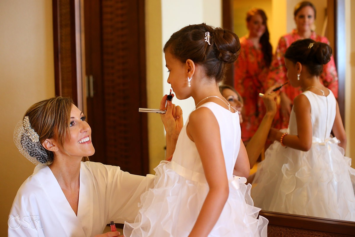 Bride putting make up flower girl, getting ready Wedding Dreams Riviera Cancun Resort, Mexico