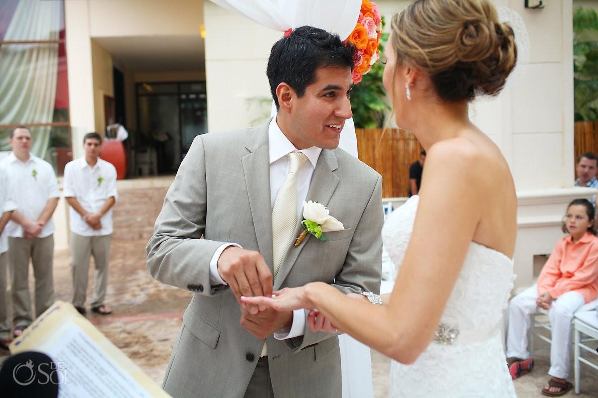 groom smile ring exchange, rain Wedding Dreams Riviera Cancun Resort, Mexico