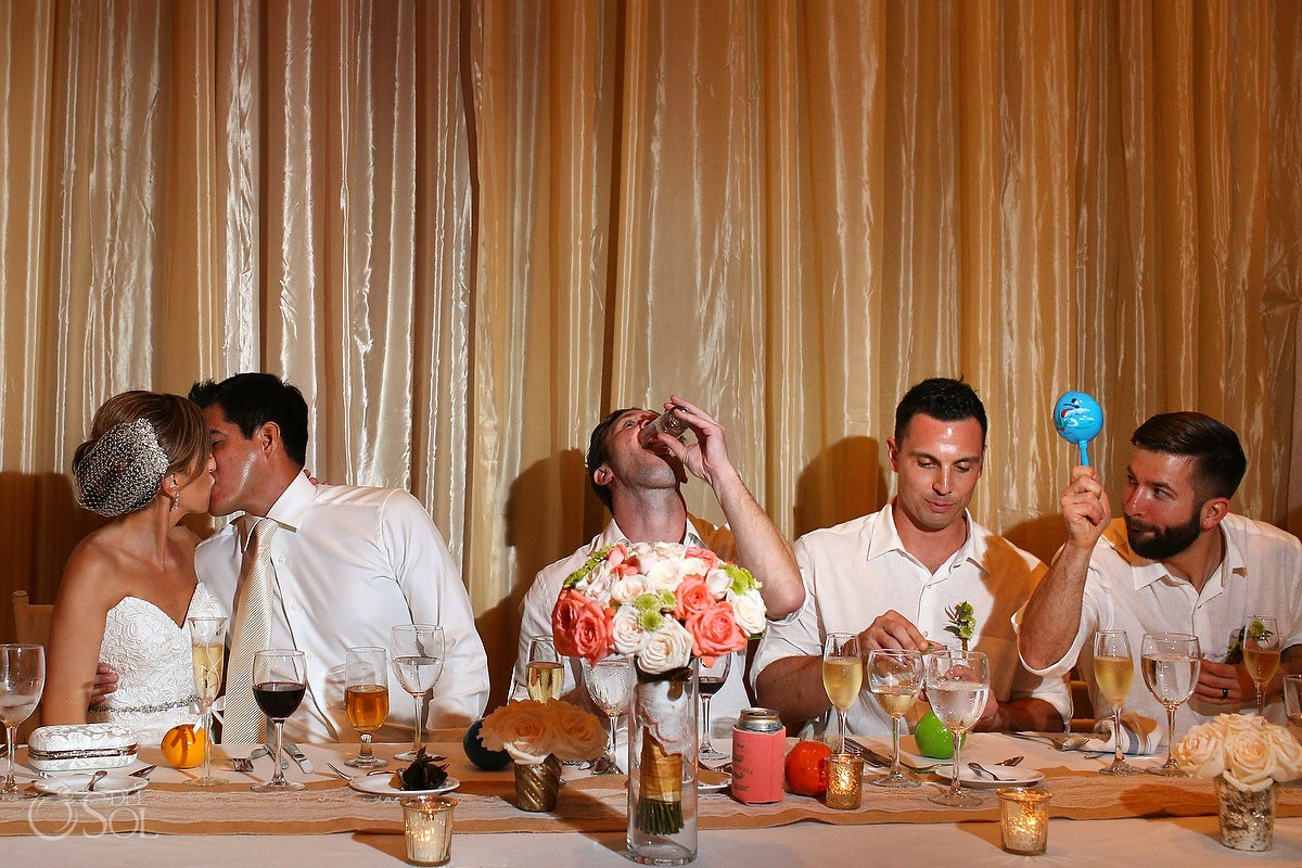 bride groom kiss, maraca shake tequila shot, rain Wedding reception Dreams Riviera Cancun Resort, Mexico