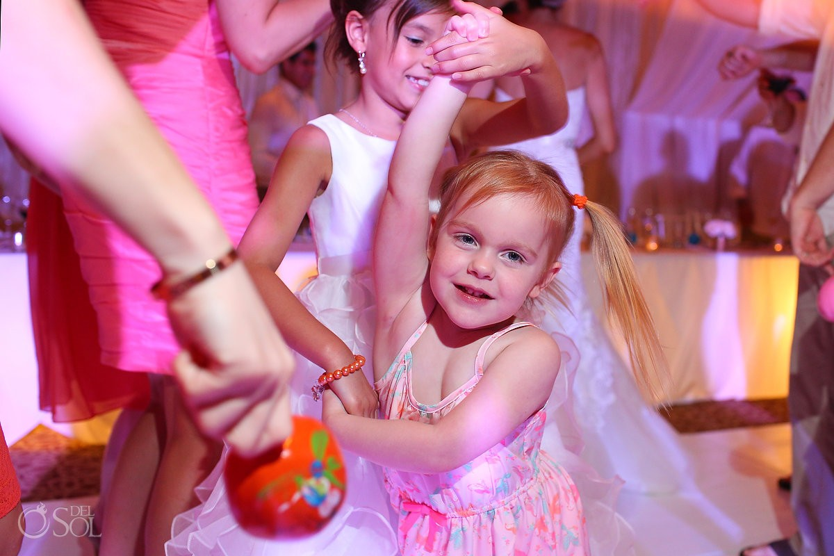cute girl dancing, rain Wedding reception Dreams Riviera Cancun Resort, Mexico