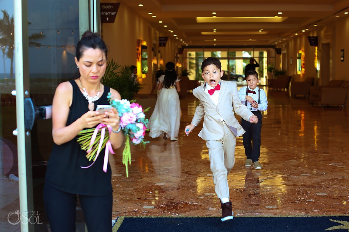 Ring bearer red bow tie funny face running, garden Wedding Iberostar Cancun, Mexico