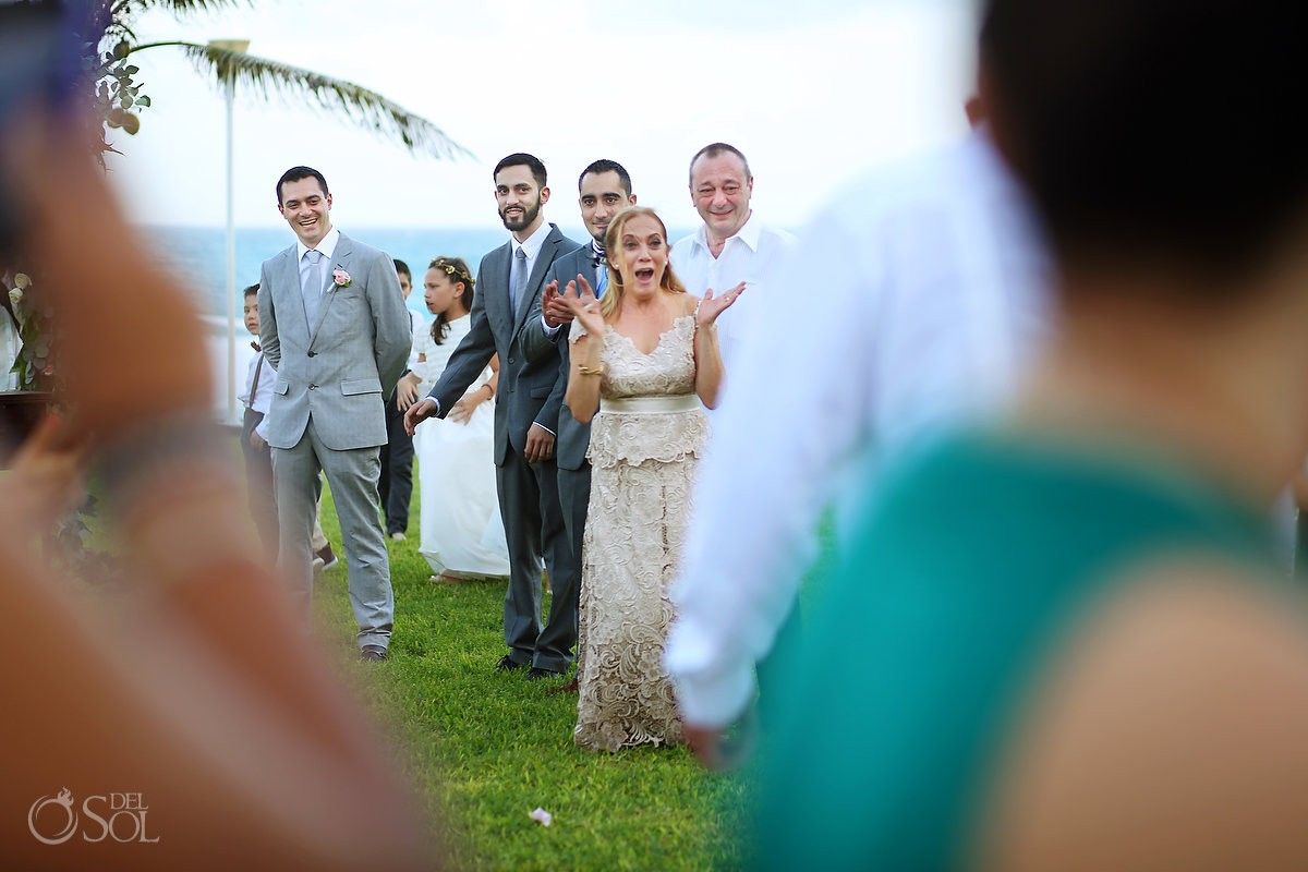 First look groom face mother in law happy, garden Wedding Iberostar Cancun, Mexico
