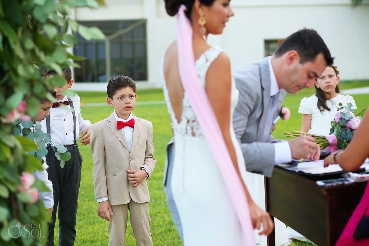emotional cute kid ring bearer red bow tie crying, garden Wedding Iberostar Cancun, Mexico