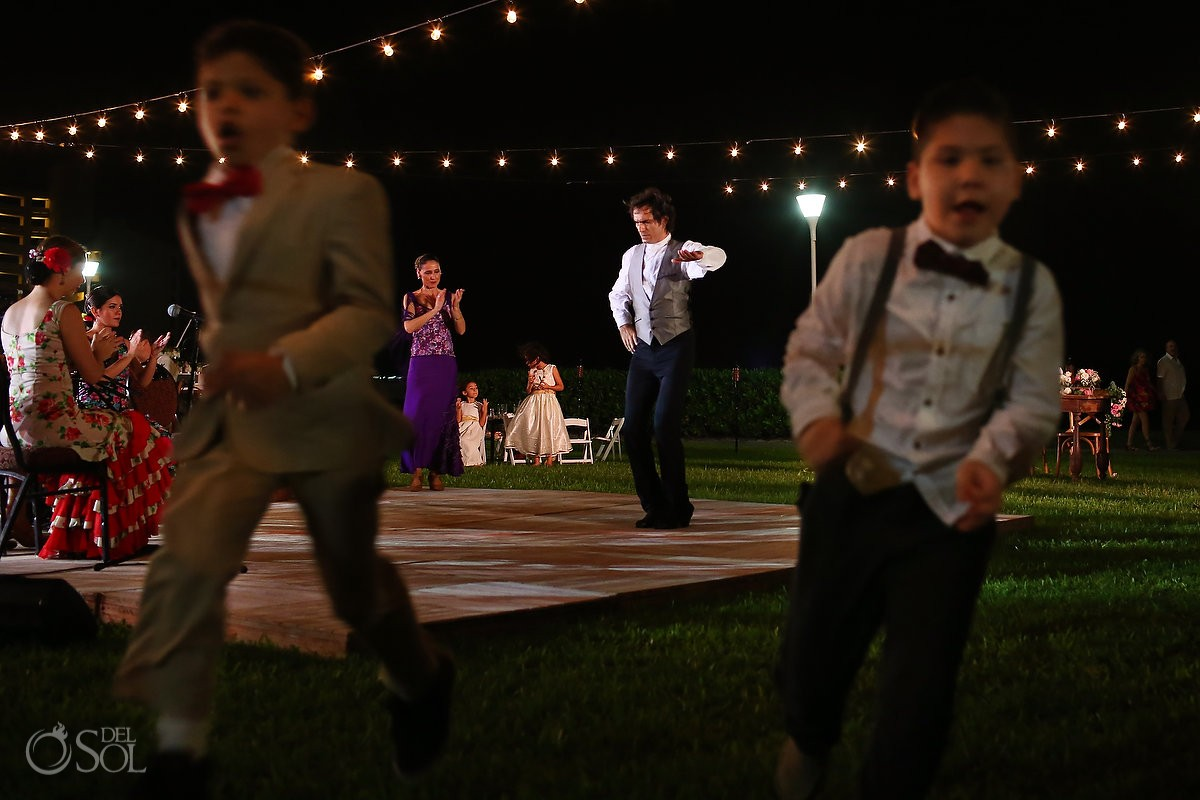 flamenco dancer framed funny kids ring bearers running, garden Wedding reception Iberostar Cancun, Mexico