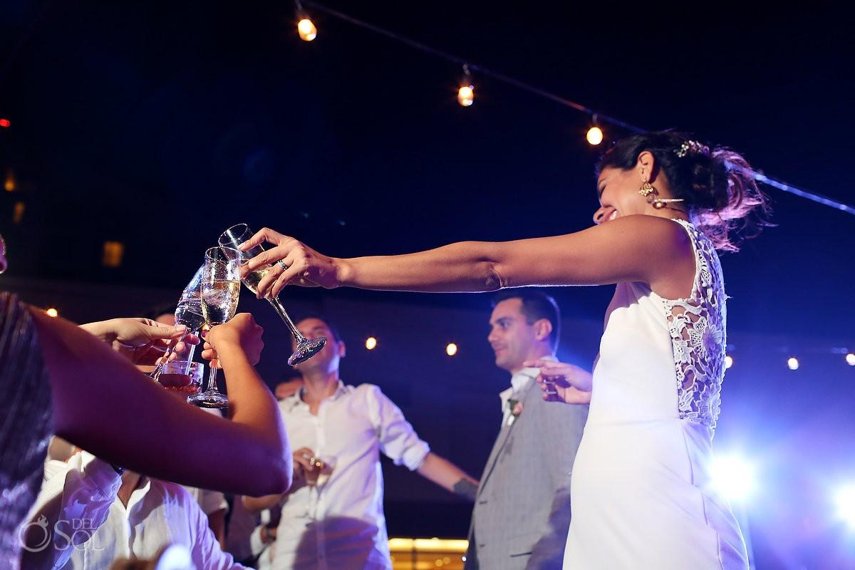 cheers champagne glasses, garden wedding reception, Iberostar Cancun, Mexico